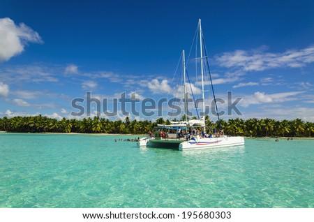 White catamaran on azure water against blue sky, Caribbean Islands  - stock photo