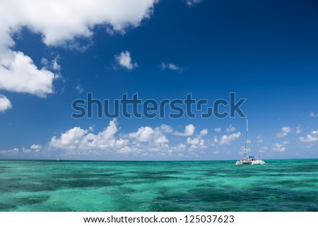 White catamaran with tourists on  turquoise ocean near Cayo Blanco, Cuba - stock photo