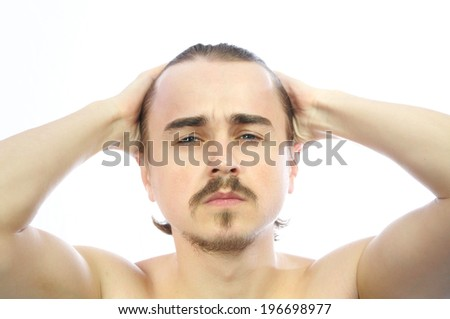 White Caucasian attractive man holding his head isolated - stock photo
