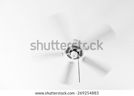 White ceiling electrical fan in motion  - stock photo