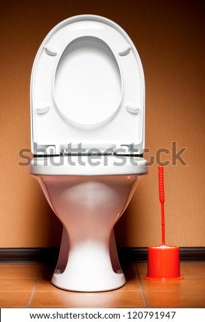 White ceramic clean new toilet in a bathroom - stock photo