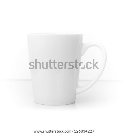 White ceramic cup above white - stock photo