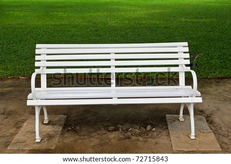 White chair in the garden. - stock photo