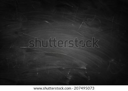White chalk marks on blackboard - stock photo