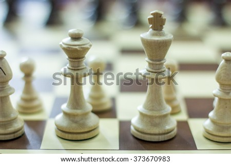 white chess pieces on a chess game early - stock photo
