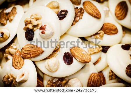 White chocolate mendiants with dried fruits and nuts  - stock photo
