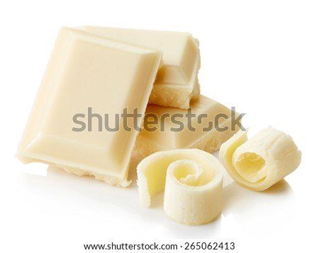 White chocolate pieces and curls isolated on white background - stock photo