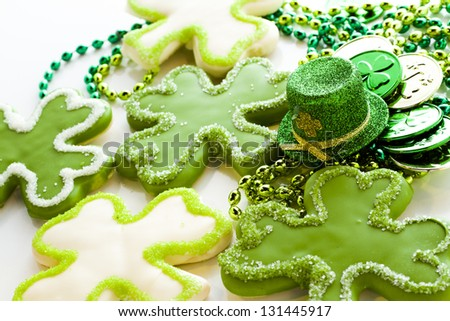 White chocolate shorrbread cookies in shape of four clover leaf for St. Patrics Day. - stock photo