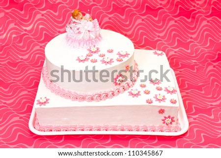 White christening cake for girl with pink decoration - stock photo