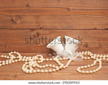 White christmas decoration bells against the wooden background as a festive copyspace composition - stock photo
