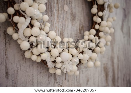 white christmas decorative wreath over the wooden background close up  - stock photo
