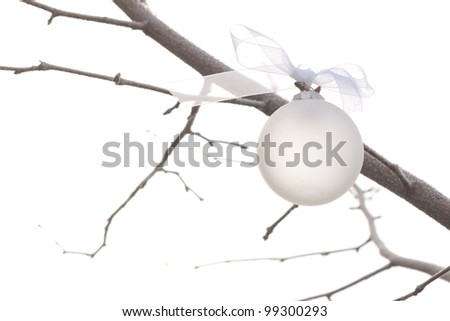 white christmas ornament hanging on a christmas tree - stock photo