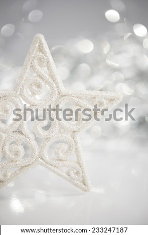 White christmas star on bokeh lights background with space for text. Merry christmas card. Winter holidays. Xmas theme. - stock photo