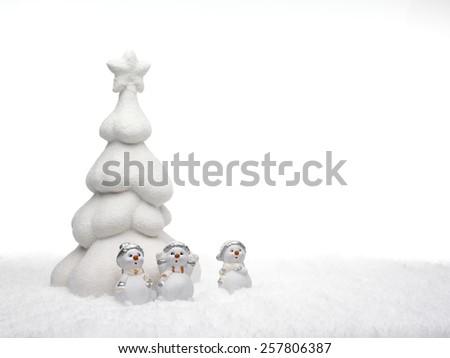 white christmas tree and little snowmen  - stock photo