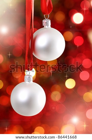 White Christmas tree decorations on lights background - stock photo