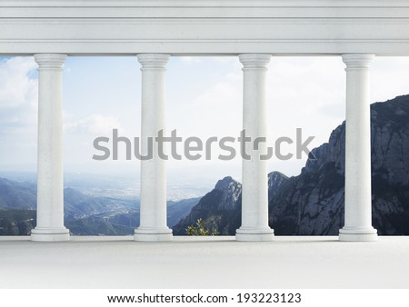 White classic interior with antique columns. Mountains in the background - stock photo