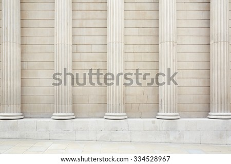 White classical columns and wall background with stone floor - stock photo