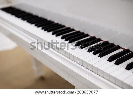 white classical piano keyboard finger pad in silent mode - stock photo