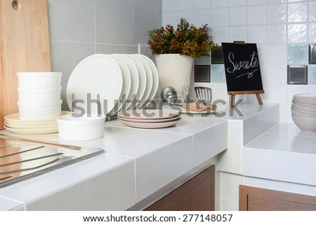white clean counter in kitchen with utensil at home - stock photo