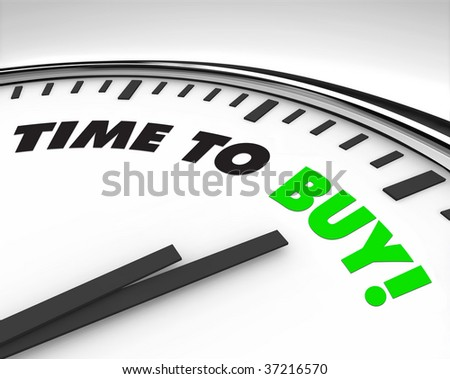 White clock with words Time to Buy on its face - stock photo