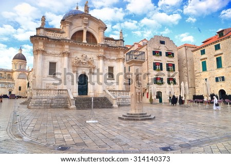 White clouds above Baroque church of St Blaise in Dubrovnik, Croatia - stock photo