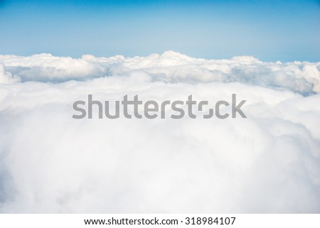 white clouds above the clouds - stock photo