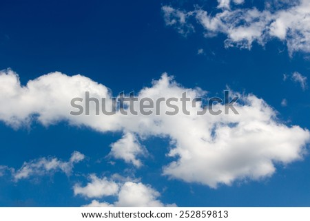 White clouds against blue sky as background - stock photo