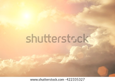 White clouds and sun. Toned - stock photo
