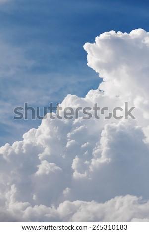 White clouds closeup in blue sky before rain - stock photo