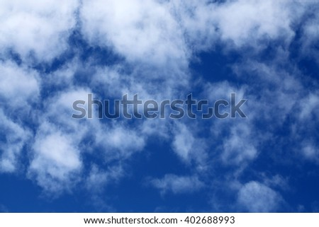 White clouds on the blue sky - stock photo