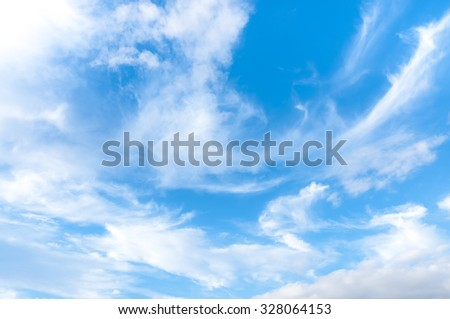 White clouds on the blue sky. Sky texture - stock photo