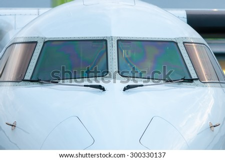 White Cockpit or cabin crew of aircraft without pilot. Close-up view. Transportation background - stock photo