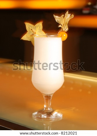 white cocktail with carambola - stock photo