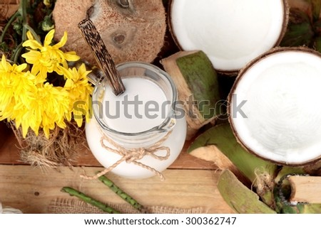 white coconut and milk on wood background - stock photo