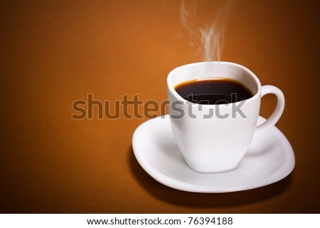 White Coffee Cup on brown background - stock photo
