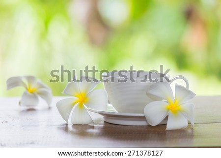 White coffee cup white flowers - stock photo
