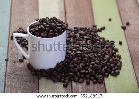 White coffee cup with beans - stock photo