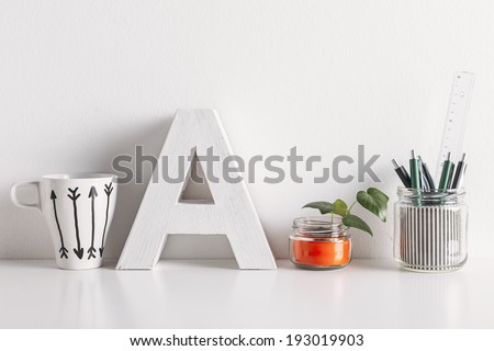 White coffee mug with arrows./ Diy office decoration on white background.  - stock photo