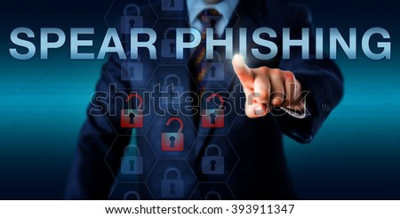 White collar attacker is pressing SPEAR PHISHING on a touch screen. Information technology metaphor and computer security concept for a highly targeted phishing attack aimed at a specific victim. - stock photo