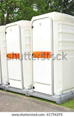 White Color Portable Toilets At A Park - stock photo