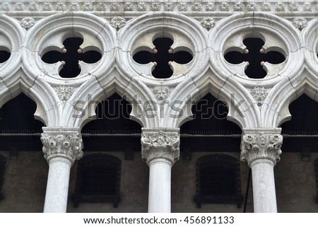 White columns  fragment with a decorative ornament in the upper portion - stock photo