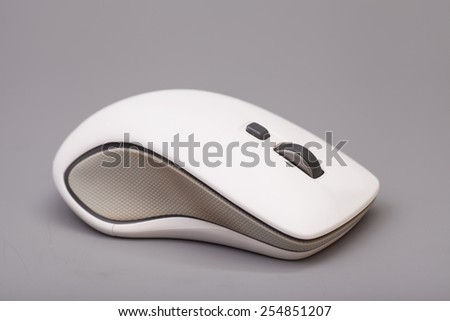 White computer mouse on gray background - stock photo