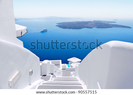 White concrete staircases leading down to the beautiful bay with clear blue sky and sea at Santorini, Greece - stock photo