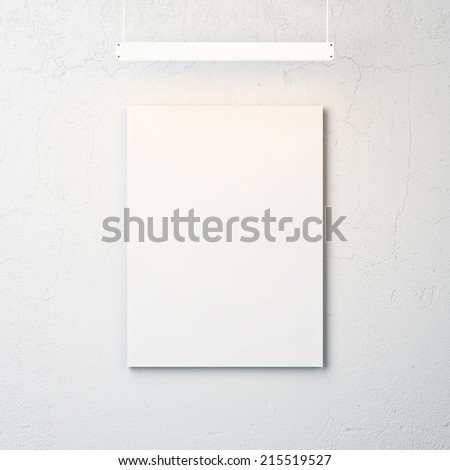White concrete wall with blank poster and spotlight - stock photo