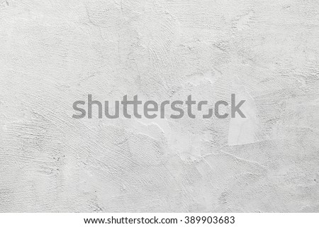 White concrete wall with stucco relief pattern, background photo texture - stock photo