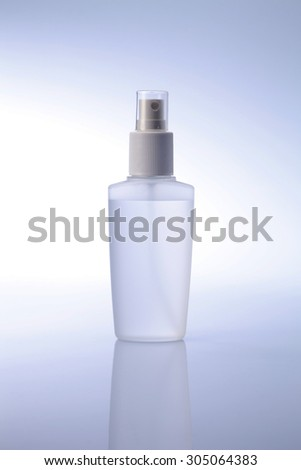 White container of spray bottle isolated over white background - stock photo