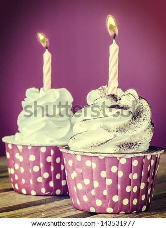 White cream cupcake with candle (Procress effect vintage style on this photo) - stock photo