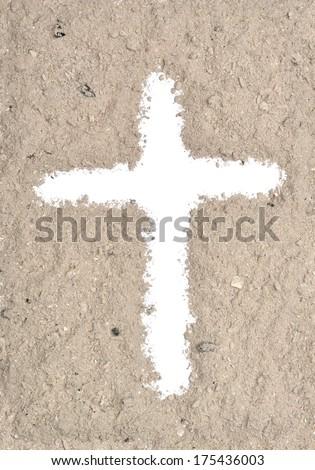 White cross in ash - stock photo