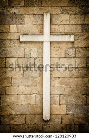 White cross on a wall Santiago de Compostela, Galicia - Spain. - stock photo