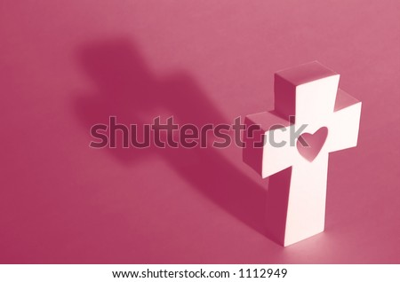 white cross with heart on pink - stock photo